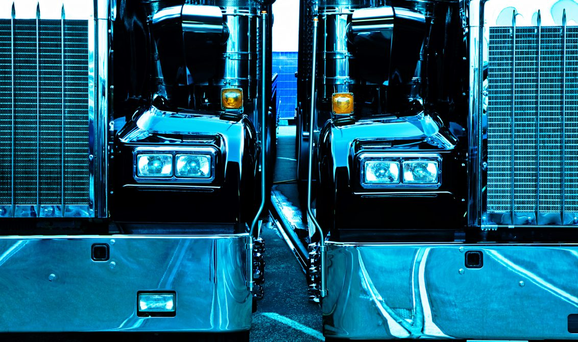 two trucks, cross processed image