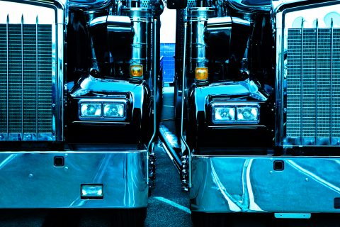two trucks, cross processed image